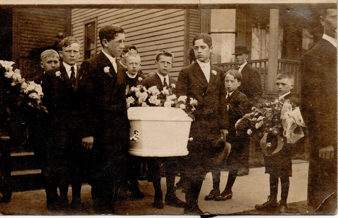 Genealogy Records by popular US online genealogist, Price Genealogy: black and white image of young boys carrying a white casket.