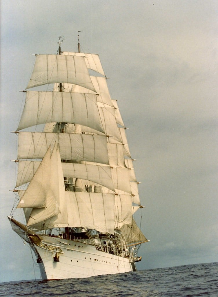 Immigrant Research by popular US online genealogists, Price Genealogy: image of a white ship with white sails on the ocean.