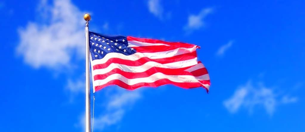 Naturalization Research by popular US online genealogists, Price Genealogy: image of an American flag waving in the wind.