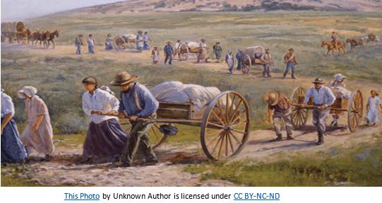 Utah Pioneer Day by popular US online genealogists, Price Genealogy: image of Mormon pioneers pulling handcarts.